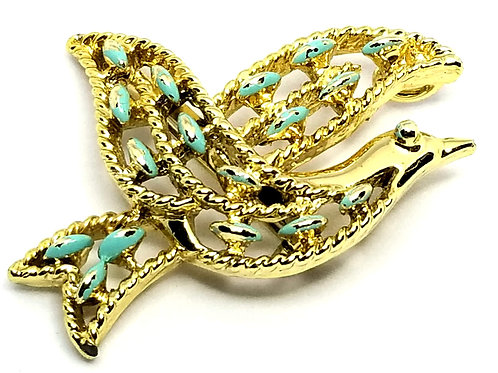 Designer by provenance, brooch, bird in flight motif, turquoise color stones.