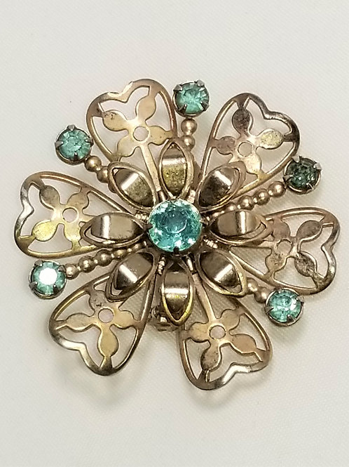 Brooch, sky blue crystals, gold tone pot metal flower base
