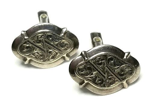 Designer by provenance, cuff links, oval, leaf motif, Sterling silver.
