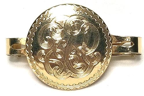 Designer by Provenance, Bolo clip, monogram look, gold tone, 1 5/8 x 1 inch.
