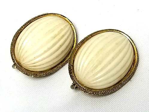 Designer by Trifari, earrings, clip on cream resin oval cabochons in gold tone.