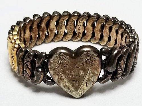 Designer by Van Dell, bracelet, stretch,heart motif, engraved on front and back.