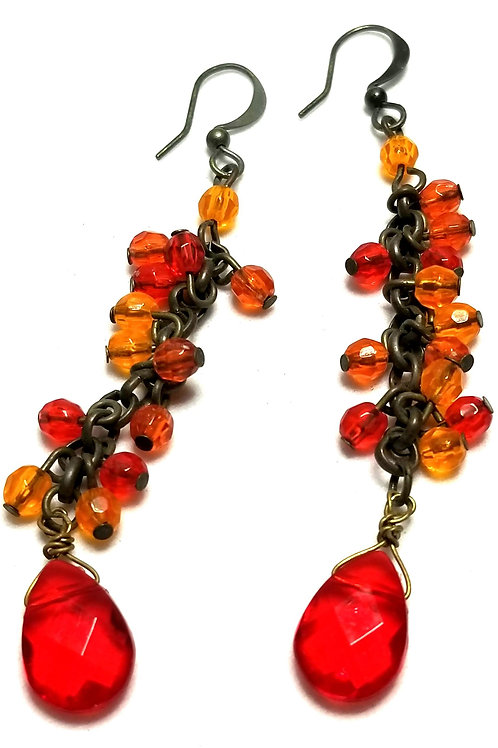Designer by provenance, earrings, pierced dangles, multi colored beads.