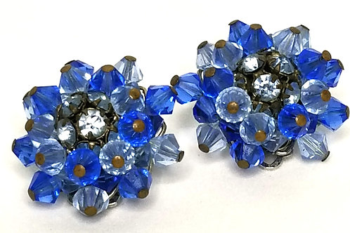 Designer by Alice Calviness, earrings, clip on flower motif, blue faceted beads.