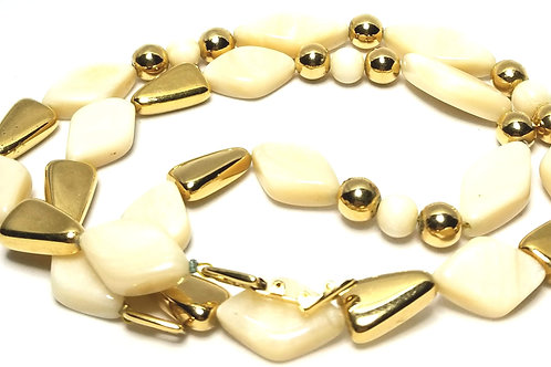 Designer by Napier, necklace, cream Lucite and gold tone beads.