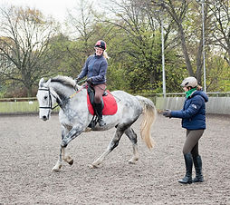 women on  horse with instructor