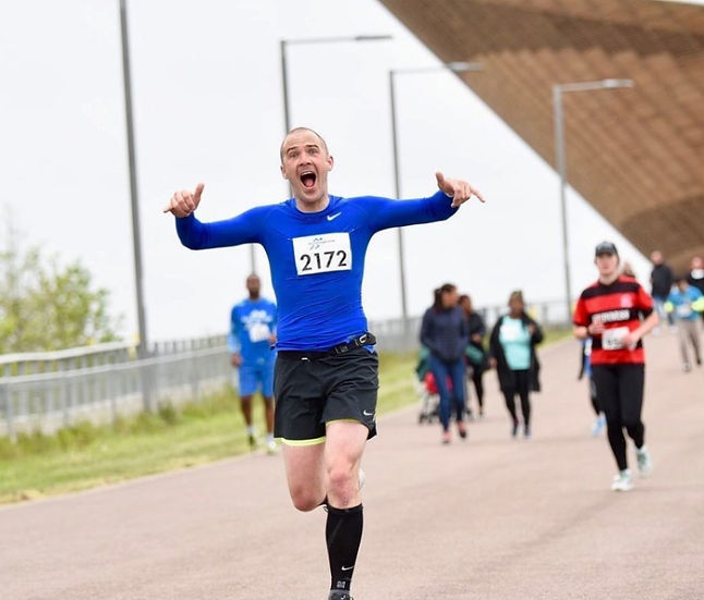 Man running on road track at Lee Valley VeloPark