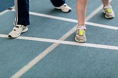Feet on indoor athletics track