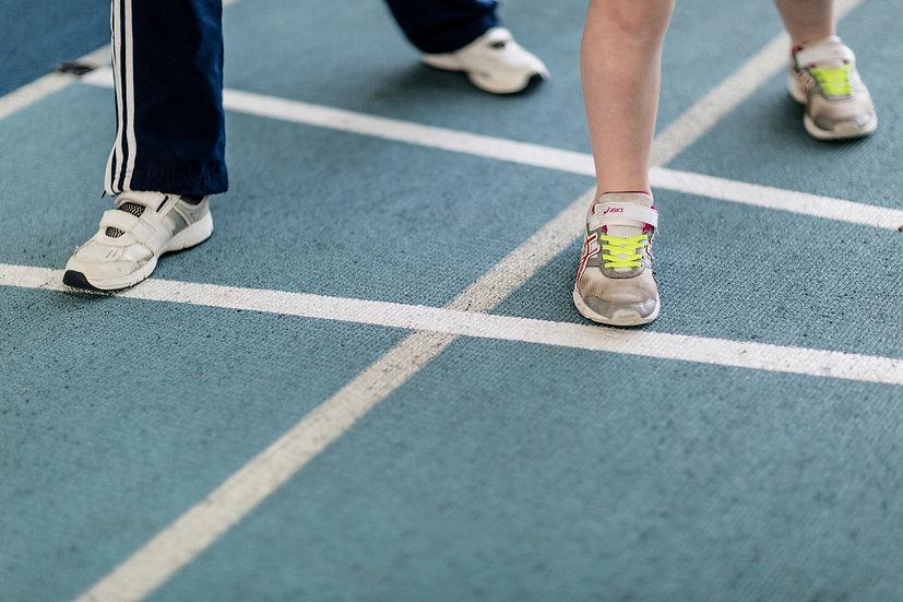 Childrens feet on running track