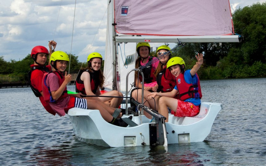 Group of children on a sailing boat
