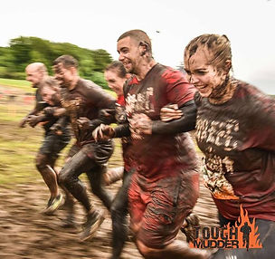 Tough Mudder 2016 competitors from Body By Finn personal training cross finish line