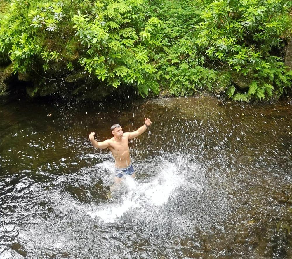 Finn Glenn swimming in the forest river. Kenmare fitness trainer Ireland