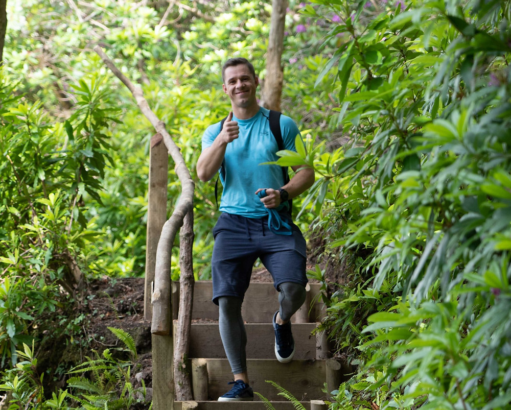Finn Glenn hiking in the forest. Irelands personal trainer. Kenmare fitness coach