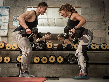 Ireland's Personal Trainer, Finn Glenn, using dumbbells with fit lady at Real World Combat & Fitness in Kenmare Co Kerry