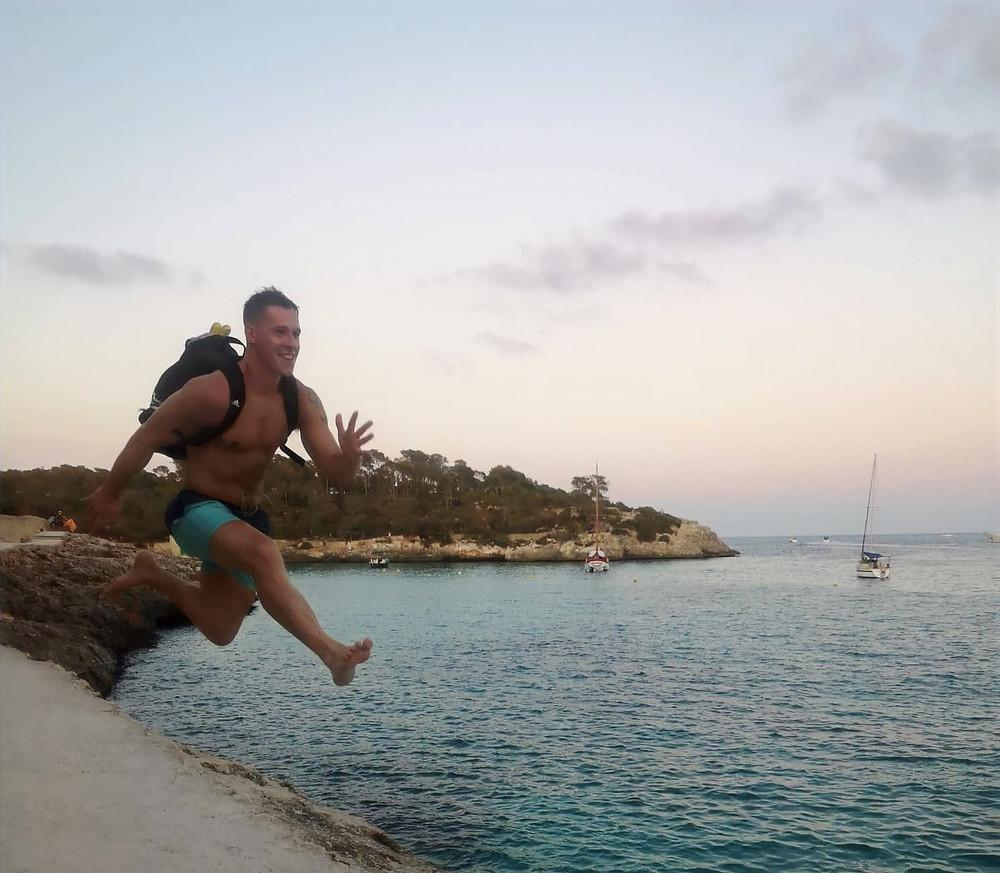 Finn Glenn Jumping on the beach in Spain. Irelands Personal Trainer Kenmare Fitness coach