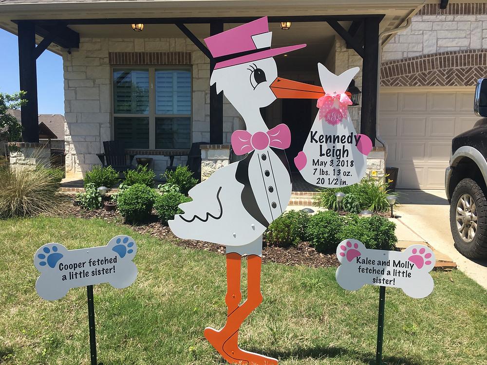 baby girl stork and dog bone signs