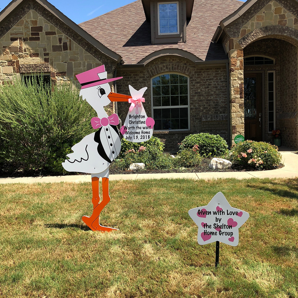 baby girl stork and message sign