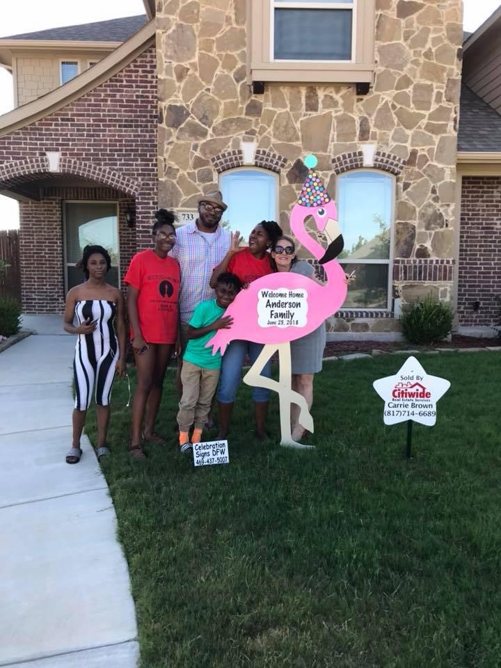 family with flamingo