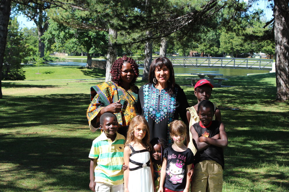 Samira Harnish, Executive Director and Founder of Women of the World with women from the Salt Lake community