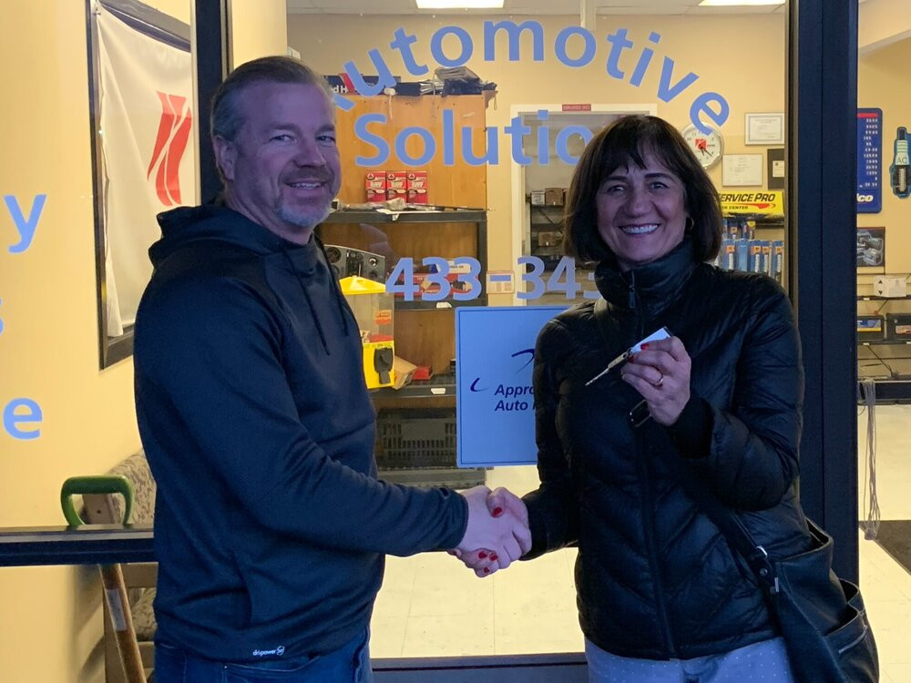 Automotive Solutions Owner Paul Goff with Samira Harnish. Automotive Solutions donated 4 cars to Women of the World to offer to clients or to use for business needs.