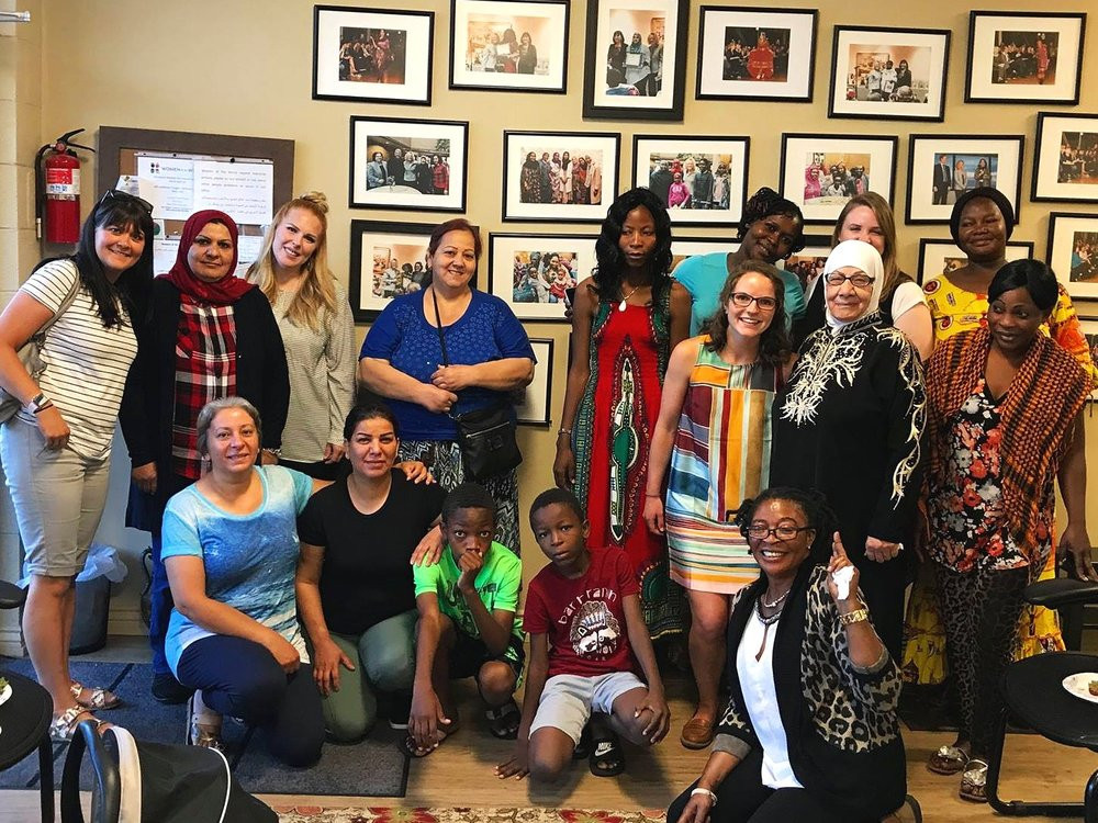 Refugee women thank Abby for her help.