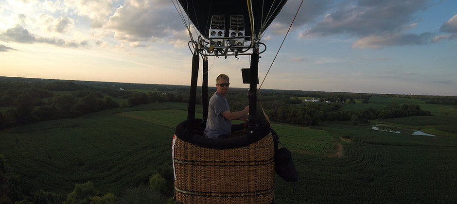 Billy Green piloting a hot air balloon