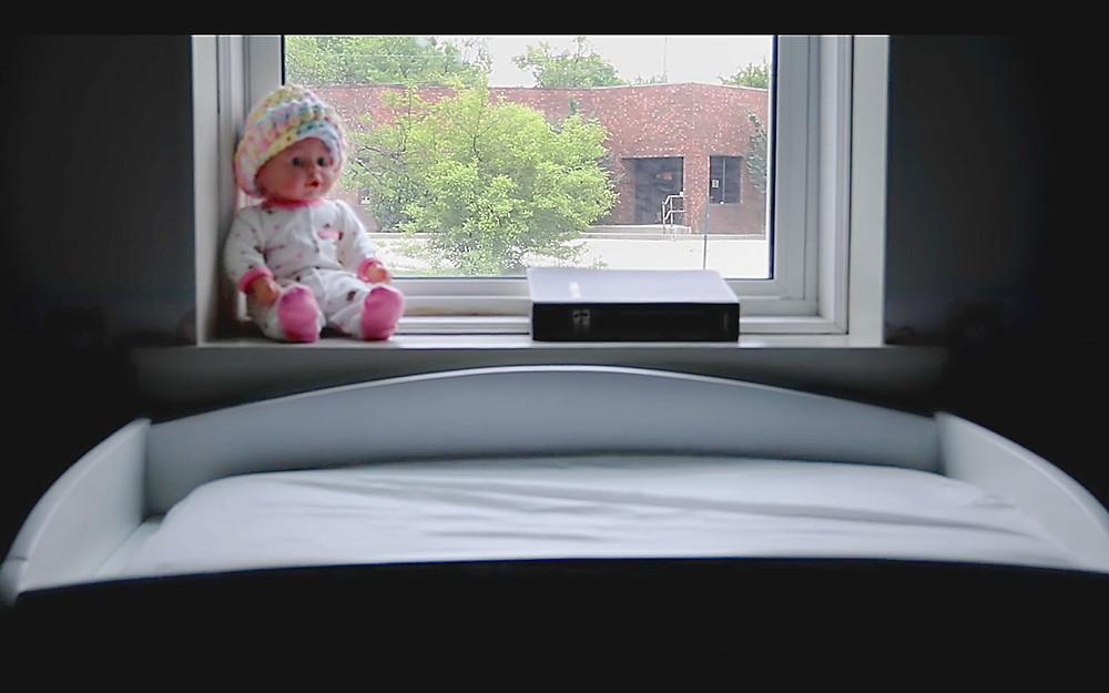 Inwood Drive Movie Still - 01 - abortion clinic outside nursery window