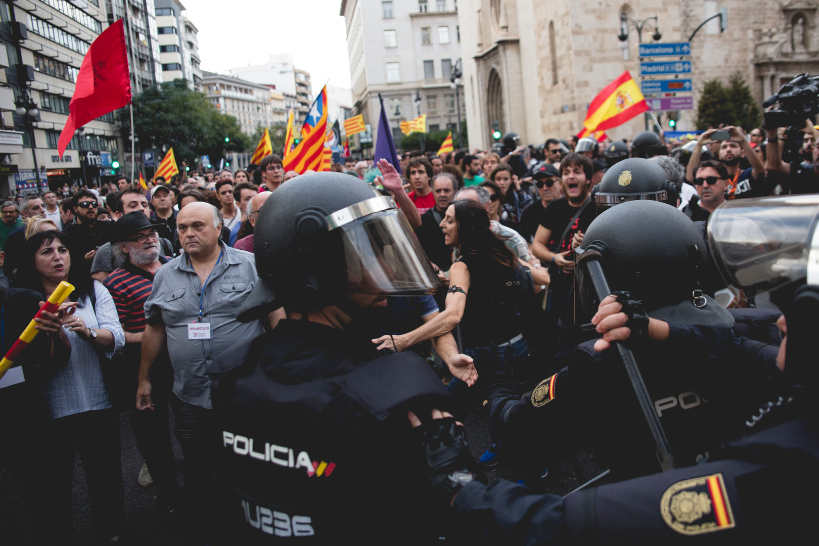 Police officers are beating some people demonstrating against the indipendence of Catalunya. Valencia, October 9th, 2017