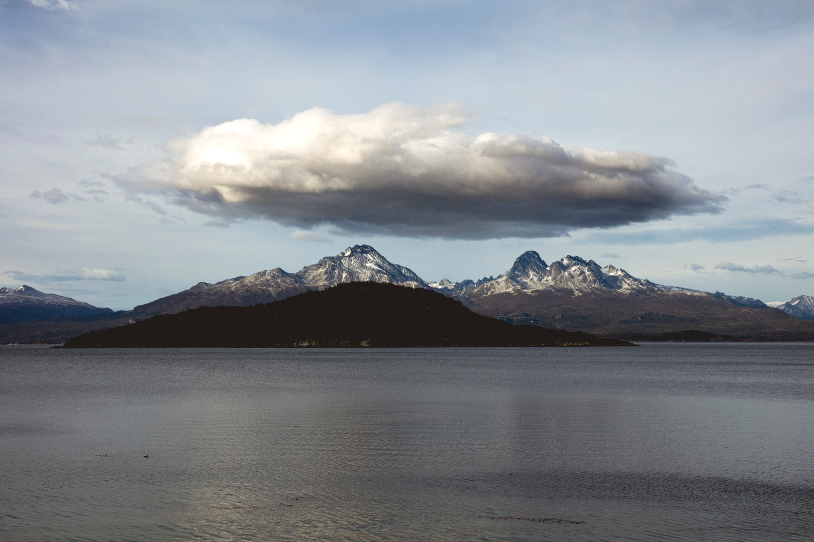 A cloud is standig over two peaks, Parque National Tierra del Fuego, Ushuaia, Argentina, April 2016