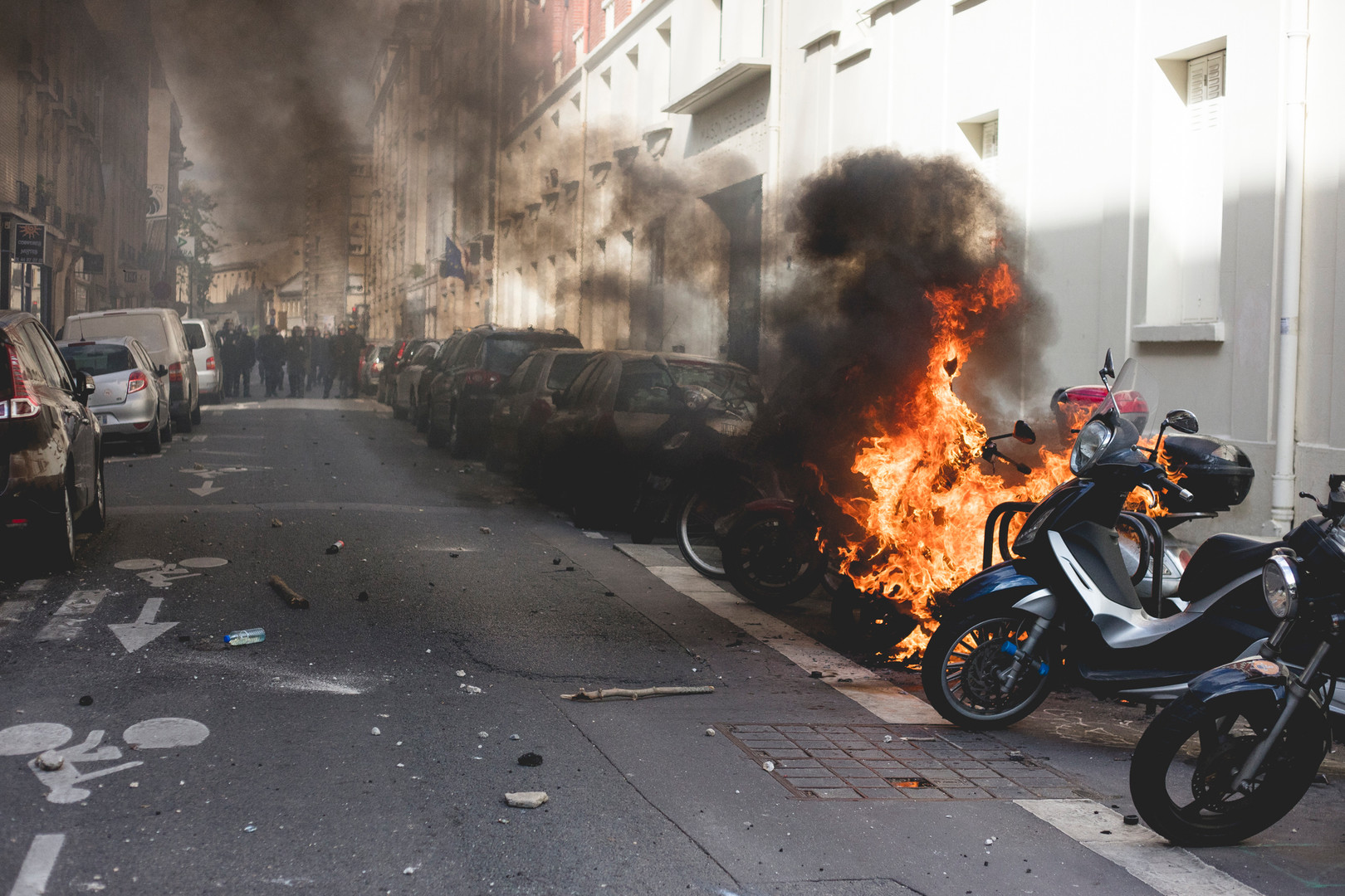 A scooter is burning during a demonstration against Marie Le Pen. Paris, May 1st, 2017