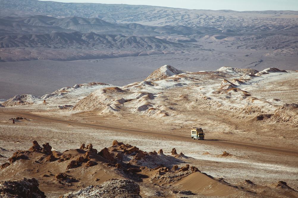 A truck is driving through Valle de La Luna, Atacama Desert, February 2016