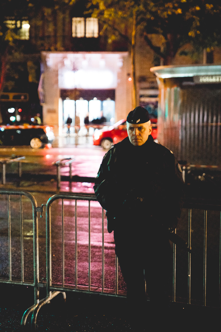 Paris, a policeman is watching the area around the Bataclan during its reopening one year after the attacks. Paris, November 12th, 2016