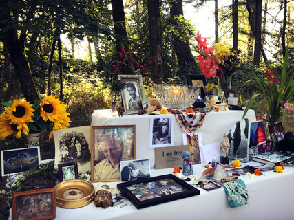 """Community Ancestor's Shrine created at the """"Drinking from the Well: The Sacred Work of Grief"""" Community Grief Ritual in Eugene, OR in July 2018. Read a story from this gathering on the link below."""