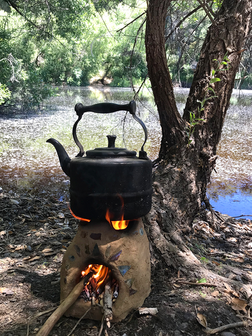 Making wild harvested hummingbird sage tea by the pond on my handmade clay rocket stove in Lockwood, CA.