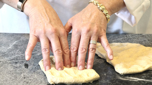 R&C hands in naan dough 2.jpg