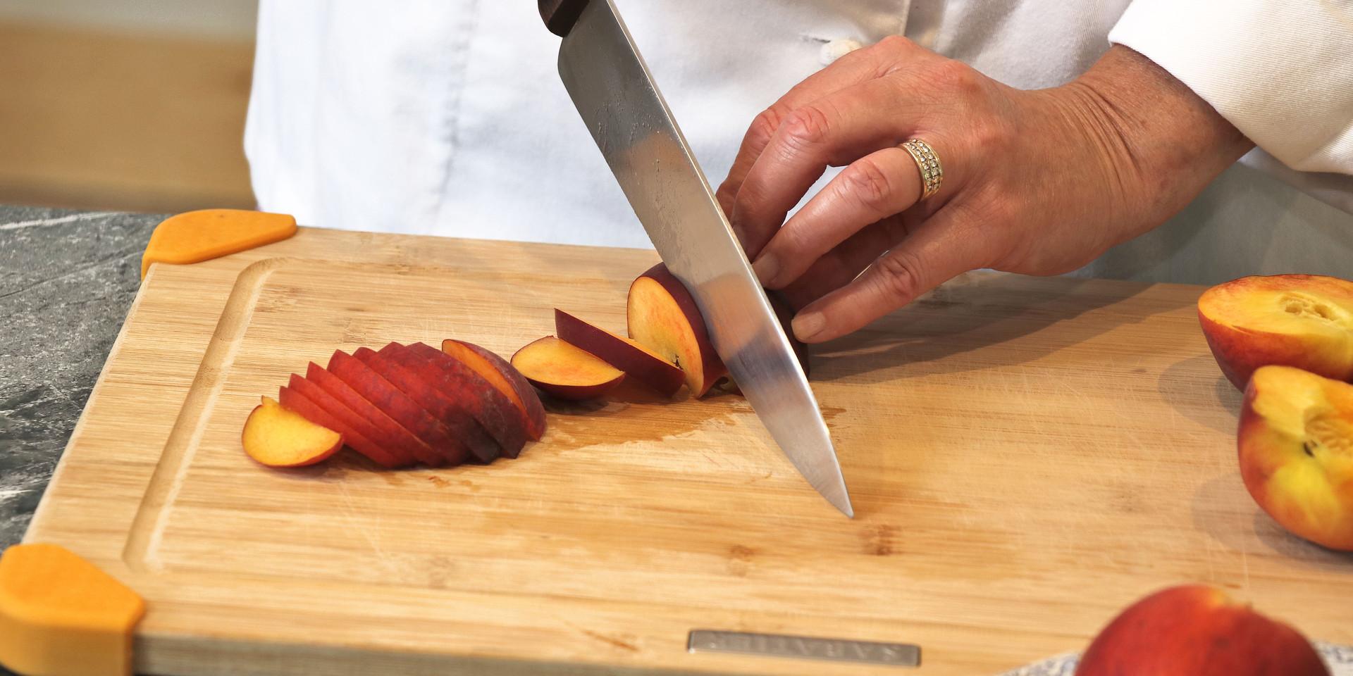 R&C peach prep slicing close up.jpg