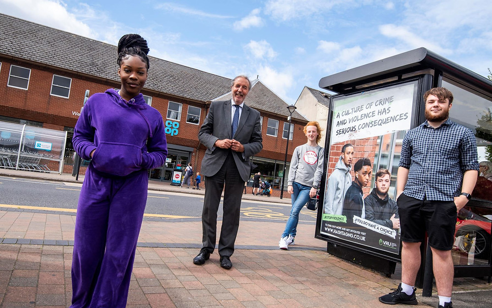 Young People with Paddy Tipping next to social media campaign poster