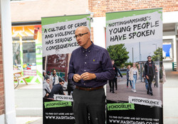 Dave Wakelin in front of #stopviolence posters
