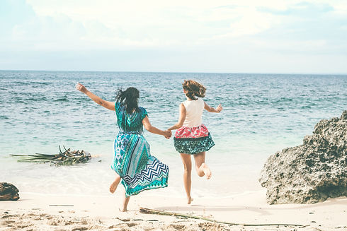Canva - Two Women Running At The Beach.j