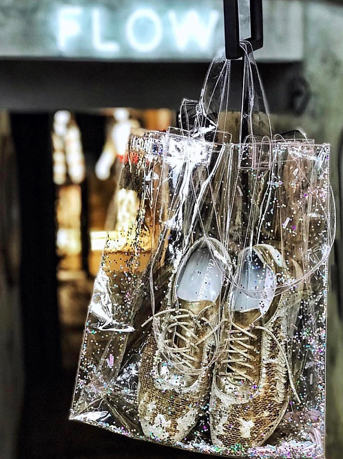 Transparent bag with shimmering glitter. €46