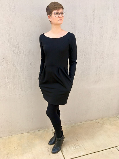 Polly - Black long sleeve dress with a pleated skirt and pockets