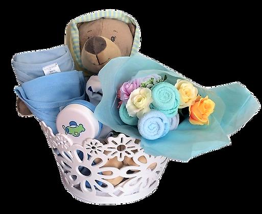 Sleepy teddy in white basket