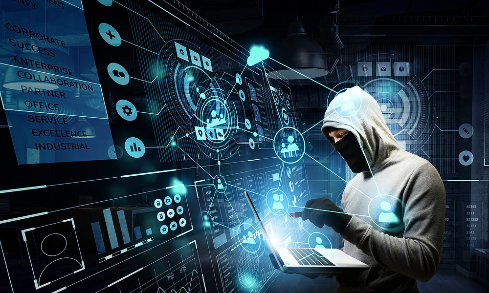 Hooded figure tapping into virtual information graphic