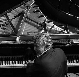 Monty at piano shot black and white.jpg