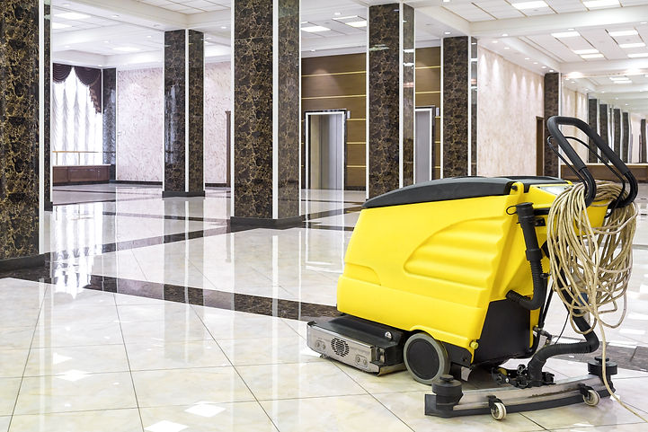 Cleaning machine in the empty office lob