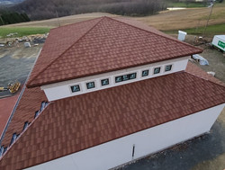 Helicopter Hangar in Pennsylvania Product is Boral Stone Coated Barrel Vault Tile in Santa Fe Color