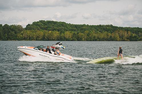 Professional boat captain, boat rental, or boat charter.