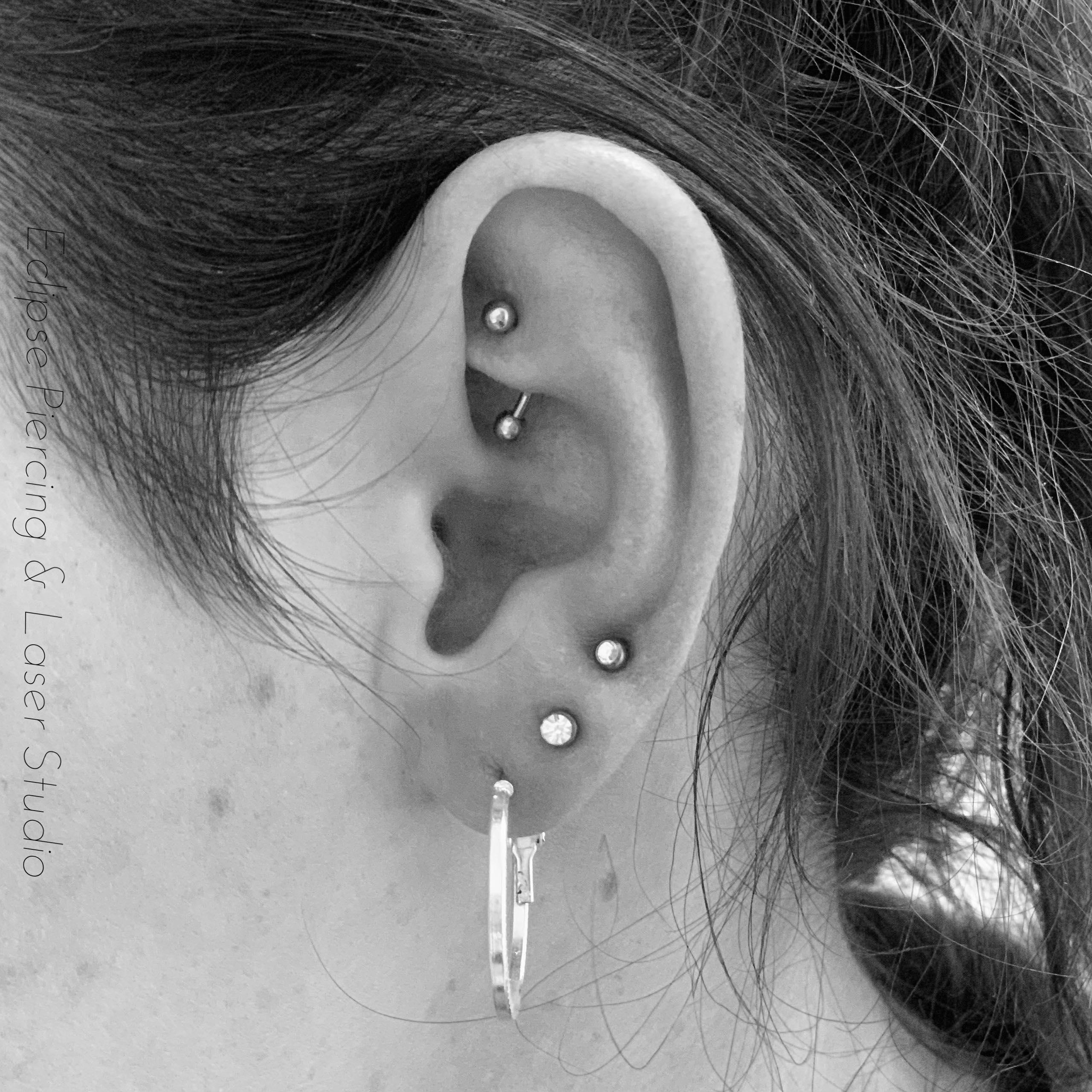 Third lobe piercing with crystal gems
