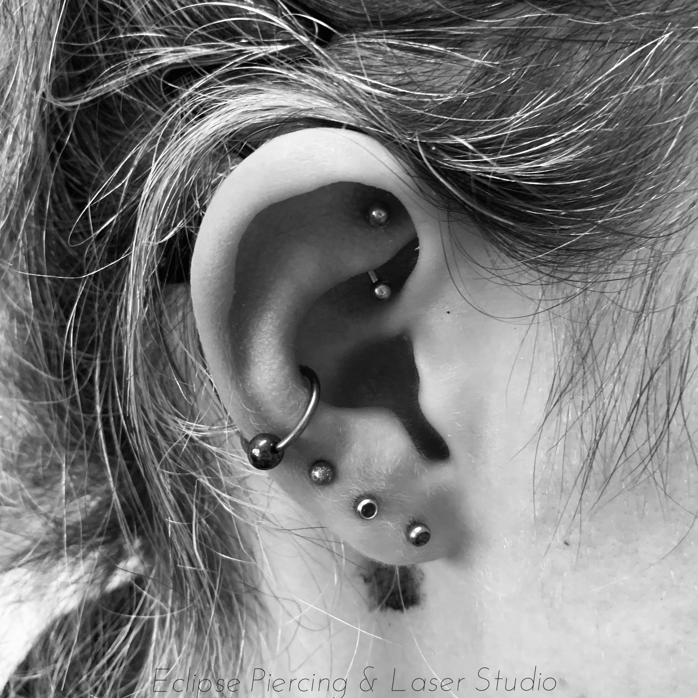 Conch piercing with a ball closure ring
