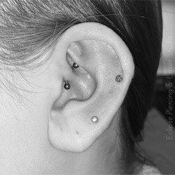 Daith piercing with a curved barbell
